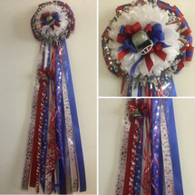 The Red, White, and Blue Homecoming Mum from Enchanted Florist can be designed in any color for any school. It includes a single mum flower, trinkets, a chain, and a braid as shown. Two names are also included in the price. HMC106