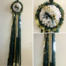 The Deluxe Memorial High School Mum by Enchanted Florist, your homecoming mums headquarters. This mum will come with 1 metallic chain. Trinkets on this mum will vary according to availibility. HMC111