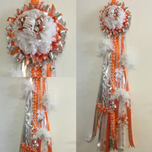 The La Porte High School Homecoming Mum from Enchanted Florist can be designed in any color for any school. It includes a single mum flower, trinkets, a Military braid, a chain and boas as shown. HMC120