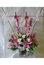 Baby Girl Clothes Line Bouquet with Socks by Enchanted Florist Pasadena - We deliver daily to local Houston hospitals and throughout Texas. Clear Lake Hospital, St Lukes Patients Hospital, Bayshore Hospital and more. Best florist in Deer Park TX for beautiful fresh flower delivery. RM101