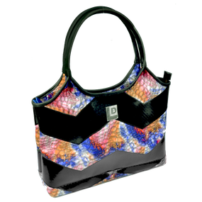 Start off your getaway or morning commute groovin with this funky psychedelic bag. This hip bag features snakeskin-inspired, kaleidoscope-colored leather accented with our reclaimed lay flat material.  Get groovin and movin with this handy zippered enclosed bag with two inside cell phone holders topped off with our metallic Landfill Dzine logo.  15X8.5X3