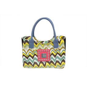"Showoff your inner ""wild child"" with this Eco-Trendy Canvas shoulder handbag.  Our ""Wild"" printed fabric bag is accented with a splash of pink featuring silver studs and our metallic logo.  This zipper enclosed handbag and zippered inside pocket makes it perfect for on the go.  Accented with upcyled black layflat material and colorful blue leather handles, this bag will show off your inner wild child with flair!  13X15X4.5"
