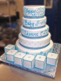 "Approximate Servings 80. Sizes: 7"", 8"", 10"", 12"", 14"" & cake blocks. A five tiered centerpiece. This edible delite is sure to impress and taste even better than it looks. The ""bling bling"" wrapping around is NOT EDIBLE. The cake block are very much edible. Please call if the name is longer than 6 letters."