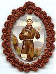 Crocheted relic badges of St. Francis of Assisi, badge of St. Francis with relic, cloth touched to the relic of the saint