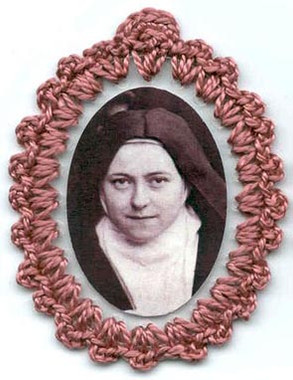 Crocheted relic badges of St. Therese of the Child Jesus, badge of St. Therese of Lisieux, Little Flower, with relic, cloth touched to relic of saint, photo St. Therese