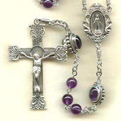 Rosary from a gallery of rosaries handmade by nuns: Amethyst beads with Sterling Silver parts, Amethyst Cabochon Our Father beads