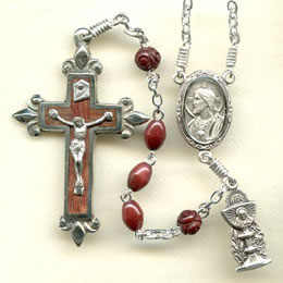 First Communion rosary handmade by nuns, 4 x 6 mm Brown Oval Cocoa Wood beads, Sterling silver parts, Fleur-de-lys rosewood inlaid crucifix, Holy Eucharist figurine side medal