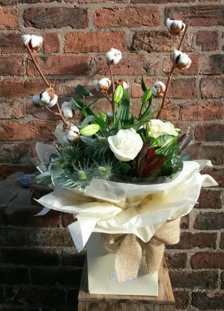 Frosty woodland handtied bouquet. Crisp white and green flowers, with natural cottonheads and leucadendron.