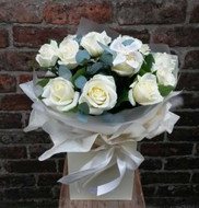 A handtied aquapac bouquet featuring 12 of the finest white Avalanche roses, arranged with salal leaves and eucalyptus. Beautifully presented and packaged, including a lovely little East of India heart tag.