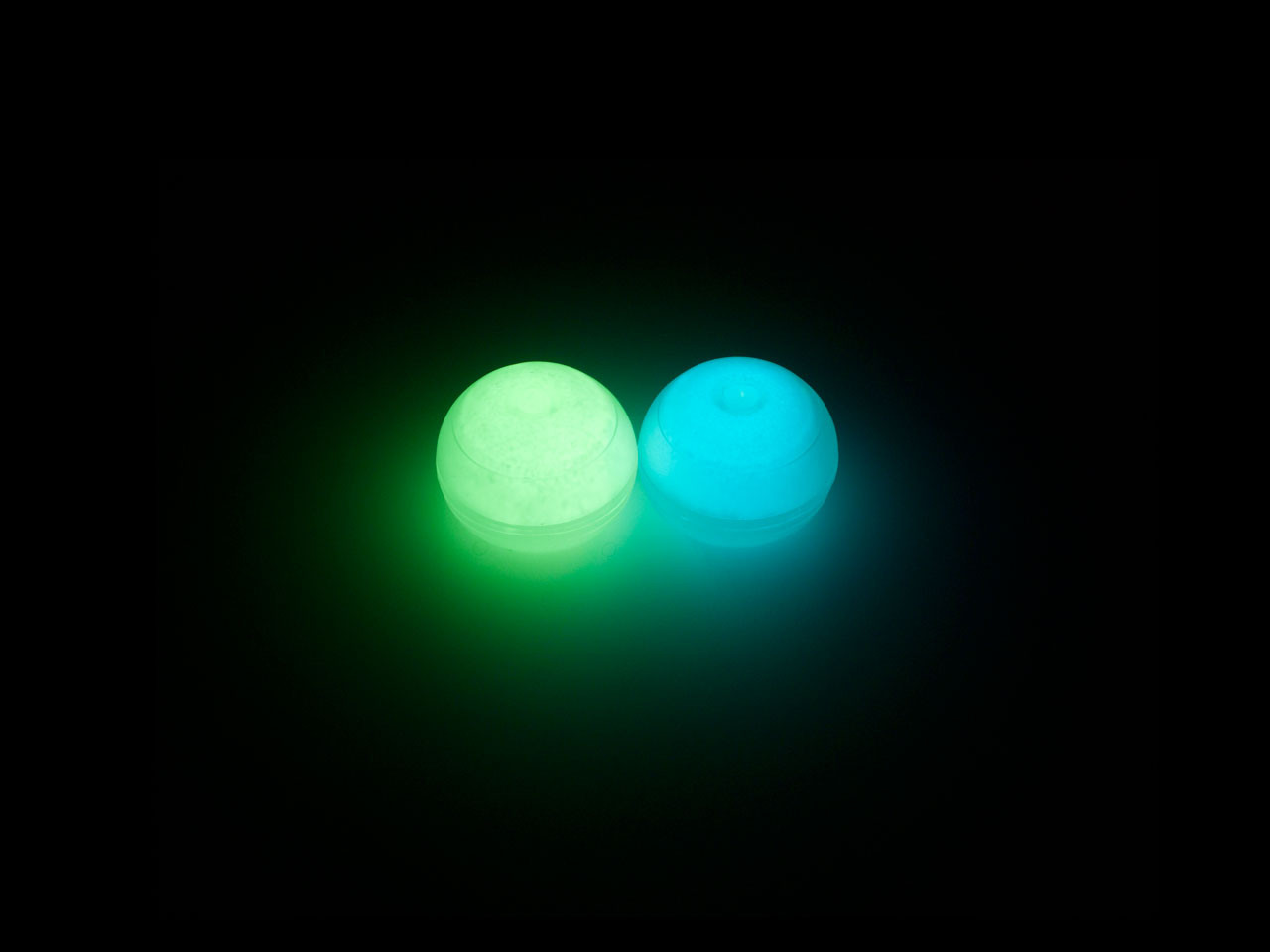 Glow-in-the-Dark PomGrips, Left: Glowstick Green, Right: Aqua Blue