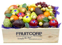 Delicious Fresh fruit in a Gorgeous hand crafted box with Ferrero Rocher chocolates.