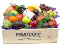 Hand crafted wooden gift box with beautifully presented fresh fruit and a bottle of  Villa Maria Sauvignon Blanc.