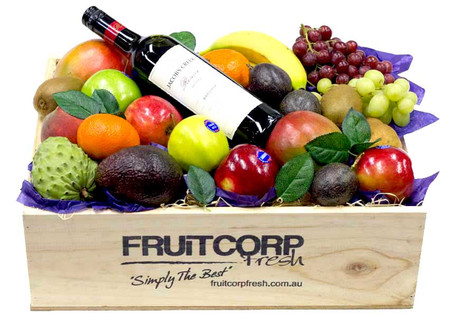 A Bottle of Jacob's Creek Shiraz beautifully presented in a hand crafted wooden box with Fresh  Seasonal Fruit.