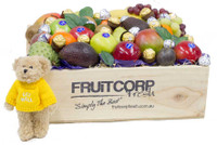 Fresh Fruit in a hand crafted wooden Gift box with Ferrero Rocher Chocolates, Baci Chocolates and a cute Get Well Message Bear.