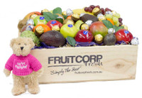 This is a Perfect Happy Birthday Gift Hamper. It comes in a wooden Box filled with Fresh Fruits, Baci Chocolates, Ferrero Rocher Chocolates and a very cute little teddy wearing a pink jumper that says Happy Birthday.