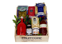 Delicious Italian cooking products from savory to sweet, all put together in a Beautiful wooden Hamper box and decorated with chilly and olive leaves.