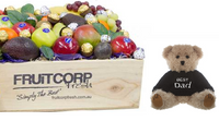 A beautifully presented fresh fruit hamper in a wooden box with a cute, little and soft Best Dad message teddy bear and baci and ferrero rocher chocolates.
