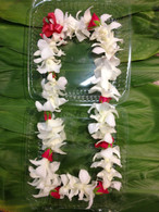 White orchid with red baby roses.
