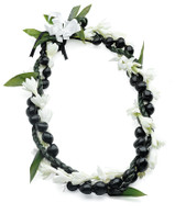 The early Hawaiians used every part of the Kukui tree. Candles and torches were made from the seeds rich with oil, as well as medicines, flavoring for foods, and of course, lei.  This handsome lei entwined with the fragrant tuberose is popular for men, especially grooms and groomsmen.  After drying the tuberose can be removed leaving the kukui lei to be worn again and again, a wonderful gift and keepsake.  Care: Sprinkle with water or lightly mist before refrigerating. The lei should be moist, but not sitting in condensation or moisture.  Life: Five to six days. Ships well.  Fragrance: Very Fragrant  Variations: Black or Brown Kuk