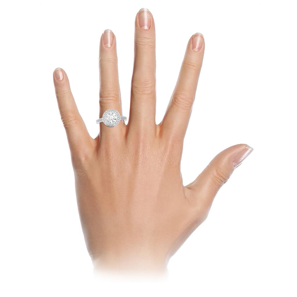 brilliant-cut-diamond-1carat-bezel-set-halo-engagement-ring-18carat-white-gold-diamond-band-stylerocks-on-hand
