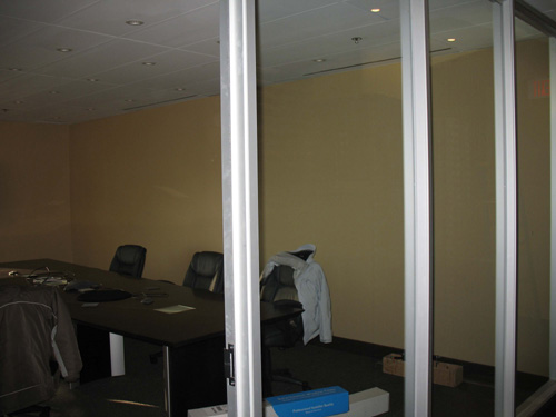 boardroom with glass curtain wall before window film