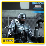 1/6th scale RoboCop Collectible Figure, specially equipped with sound effect and the Mechanical Chair (Docking Station). Fans will be able to reenact the notable scene where RoboCop has a dream and begun to remember who he was before becoming a cyborg.   RoboCop series is the latest addition to Hot Toys' MMS Diecast Series in which the collectible figures are made of diecast material, specially designed to look more closely to the realistic RoboCop in the movie. The MMS Diecast Series will take fans to the next level of authenticity, focusing on the materials, fine details and engineering of the collectible figure.   The movie-accurate RoboCop Collectible Figure is highly-detailed. It features a new sculpted body, black, light grey and silver armor, interchangeable lower faces, working thigh gun holster and ability to speak memorable quotes from the movie.