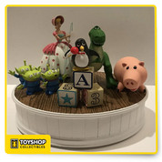 Designed by Disney artist Derek Lesinski Fully sculptured figure Artist's printed signature on base Inspired by Disney's animated classic Toy Story Characters include Bo Peep, Hamm, Rex, Wheezy, and three Space Aliens Decorative oval base with rubber feet Resin
