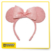 Get festive like the sweet stylista with this elegant and fun Millennial Pink ear headband. Pink sequins crafted over soft, padded Minnie Mouse ears makes your trip to the Park just that much more magical!   Soft, padded mouse ears Satin and Sequin Pink overlay Velour non-slip interior Polyester One size fits most adults and kids Imported