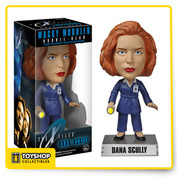 This X-Files Dana Scully Bobble Head stands about 6-inches tall atop her name display base. Featuring the likeness of actress Gillian Anderson, this bobble head comes in a window display box. Dana Scully is pictured in her navy blue coat with a flashlight in her hands and her F.B.I. badge on her left chest. Trust no one, but do pick up this Dana Scully bobble head!