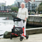 "Escape Rollator Charcoal -19"", 21"" and 24"" seat height with lady at harbor"