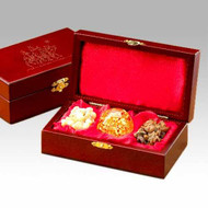 Gifts of the Three Kings Boxed Set, Gold Frankincense and MyrrhThe Original Gifts of Christmas ~ Gold Frankincense & Myrrh  A silhouette of the Magi following the Christmas star - printed in gold - tops the lid of a richly detailed box.  The cherry stained finish of a solid wood chest is offset by the unique brass latch. The box makes a beautiful, meaningful and dramatic presentation.  The interior of the box is striking with its luxurious red satin lining on both the padded lid and base. The large tears of frankincense, hand-blown glass ball with 23kt gold inside and crystals of Arabian myrrh are nestled together in this beautiful collection of the Gifts of the Three Kings.  - Authentic 23 K Gold in Hand Blown Glass Orb  - Authentic Frankincense & Myrrh, too  - Satin Lined Hand-Crafted Wood Display Case  - Wonderfully Gift-Boxed  - Certificates of Authenticity and History & Care Instructions included. 6.75 x 3.75 x 2.00.
