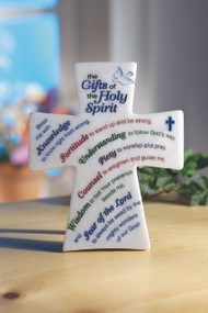 """Marble tone Gifts of the Holy Spirit  plaque is cross shaped and features an etched design. Hang, or stand with easel backer. Gift boxed.  6"""" x 7 1/8"""""""