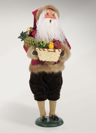 Holiday Santa loves to entertain during the holiday season. Santa is dressed in his finest coat trimmed with fur.