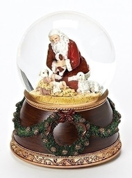 "6"" Musical Kneeling Santa dome that plays ""Silent Night"". Base has wreath and two sheep with baby around it. Dimensions: 6""H"