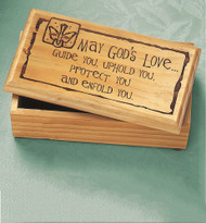 """Wooden box with lid is just the right size for holding small gifts, jewelry or rosaries.  Features a special laser engraved design that reads:  """"May God's Love guide you, uphold you, protect you and enfold you"""".  Box measures 7 x 3.5 x 2.25 inches in size.  Gift Boxed"""