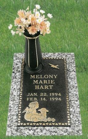 CHILD Bronze over granite with vase