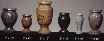 Granite vases of sizes and colors.