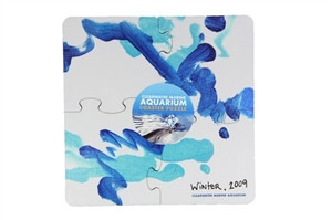 """Sick of bland, meaningless coasters? Rest assured— place your drinks on this coaster set of 4, featuring one of Winter the dolphin's very first paintings, """"Winter's Ocean Blue."""" Secure yours and let these puzzle shaped coaster pieces bring inspiration and individuality to your home!"""