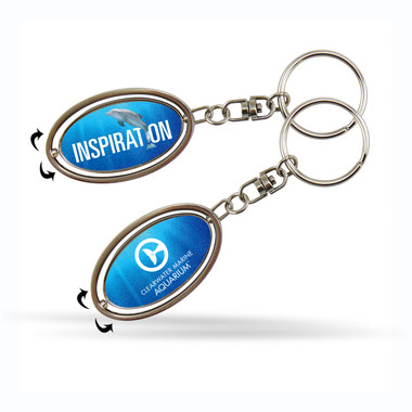 Spinner keychain features Winter the dolphin and CMA logo!