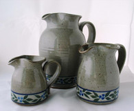 Small, Medium, and Large Pitcher in Speckled Stone with Blueberry Trim glaze.