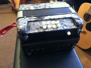 The Boxeen 4 voice 2 coupler button accordian