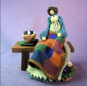 Amish Quilter on Bench Polymer Clay Figurine