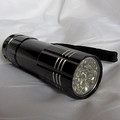 Black light hand held flashlight for close inspection.
