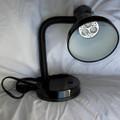 385 nm black light mounted on a desk.