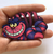 Hungry Designs Cheshire Cat Brooch - In Hand - Cobalt Heights