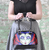 Jubly Umph Evil Sorceress Handbag - In Action - Cobalt Heights
