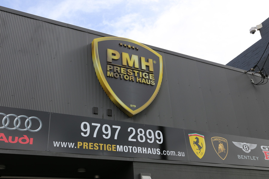 Prestige Motor Haus Sign