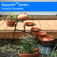 Tricycle Solar Birdbath Fountain Cascading Solar Powered Fountain  Sale! End of year sale!!!  AquaJet SF Tricycle: With the unique Solar Tri-Cycle Fountain you can easily upgrade your yard garden or patio! Because this Tri-Cycle Fountain is powered by the sun it provides the soothing sound of water without wiring which leaves you free to place it where you like. The solar panel is built to allow it to be placed up to 10 feet away from your fountain in order to optimize its exposure to the sun.  This fountain is harmless to the environment and will not add to your electricity bill! Choose a favorite type of plant for in the flower pot located in front of the handles to add a touch of your own.  This fountain comes with a higher performance pumping system with a built in capacitor ensuring longer pump life!   Specifications:  Weight: 12 lbs Dimensions: 24 H x 30 L x 12 W    Features:  5 tier fountain with a flower pot in front Durable rustic iron finish and construction 3 wheels to place on uneven terrain Place the solar panel up to 10 feet away from fountain