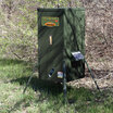 Texas Hunter 300 lb. Stand and Fill Directional Wildlife Feeder in the brush shown with optional SP2W Solar Charger.