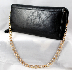 Rear view showing gold shoulder chain